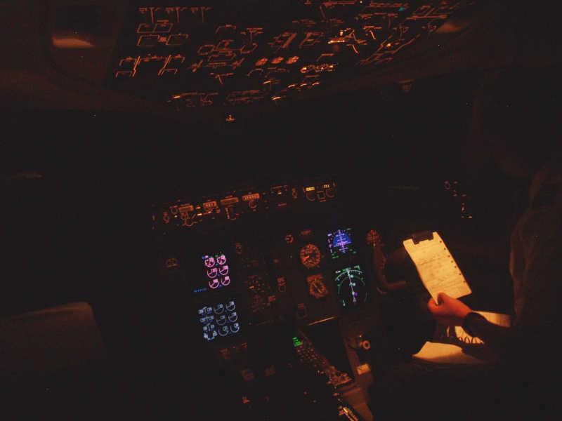 Chart study in dark flight deck, 757 jetliner, 767 jetliner, international airline, hf radio, vhf radio