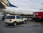 ATA Boeing 737, unloading cargo <br>U.S. currency <br>Midway Airport