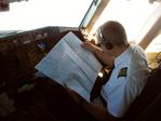 ATA First officer studying aero charts