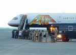 ATA Airlines Military Charter <br>Passengers deplane...