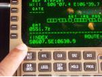 Entry of Jakarta gate coordinates into Viva Macau Boeing 767 flight management computer